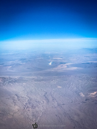 8668 Was that Area 51 way off in the distance with the weird super bright reflection that stayed on the plane for a long long time? No, but that would make for a better story
